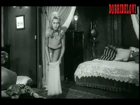 Brigitte Bardot getting dressed scene from Ravissante Idiote