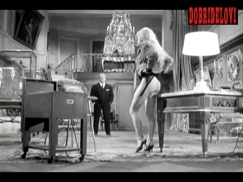 Brigitte Bardot hikes up her skirt at desk foot scene from En Cas de Malheur