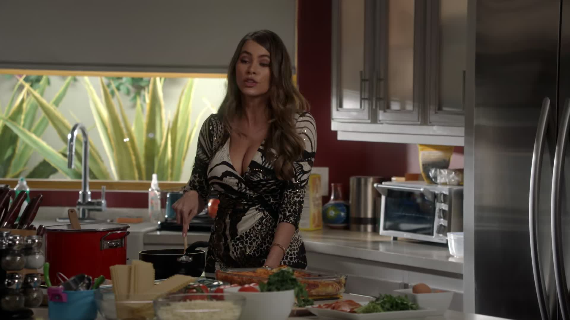 Sofia Vergara huge cleavage making some lasagna