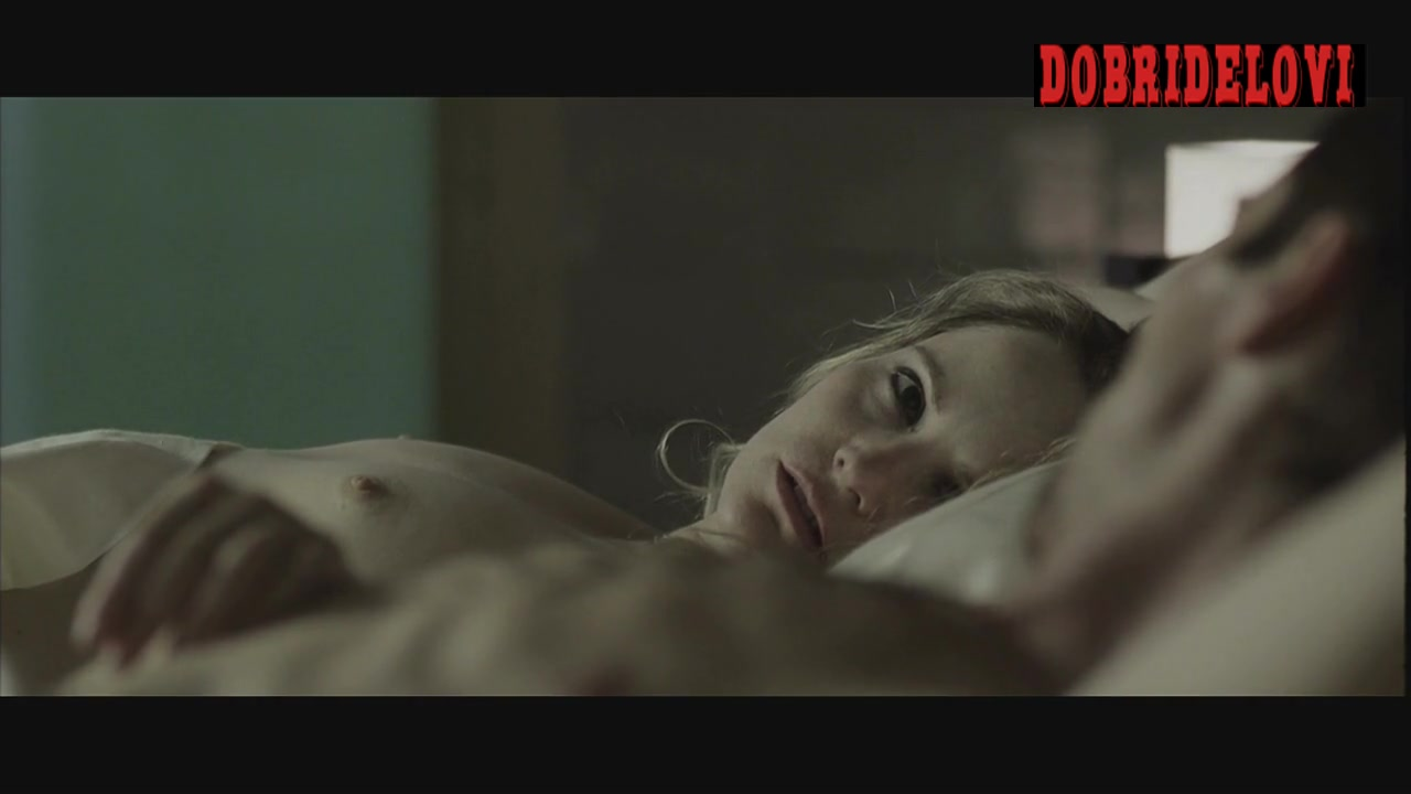 Jennifer Jason Leigh lays in bed with Christian Bale in The Machinist