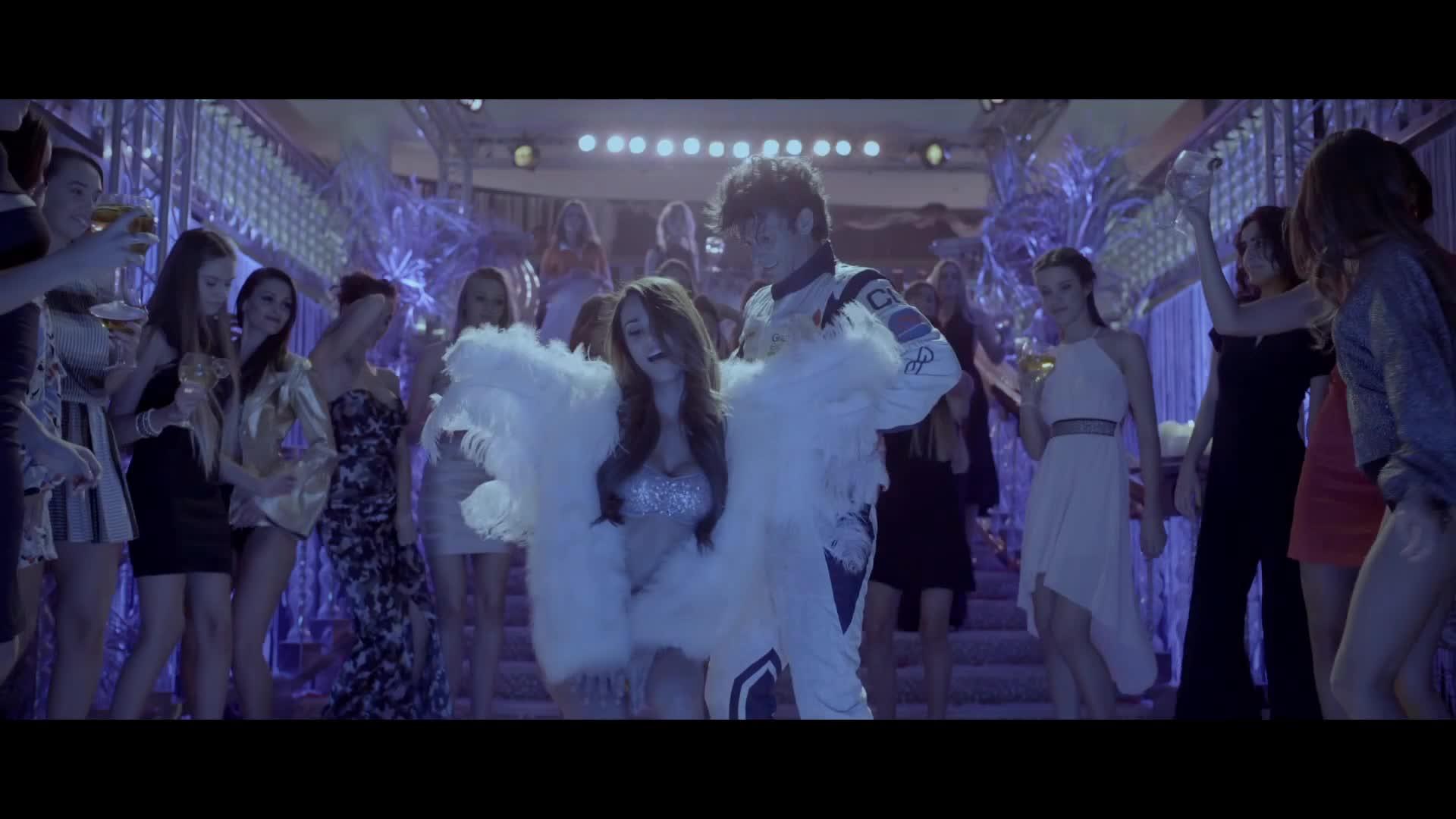 Yanet Garcia dancing in club dressed like an angel