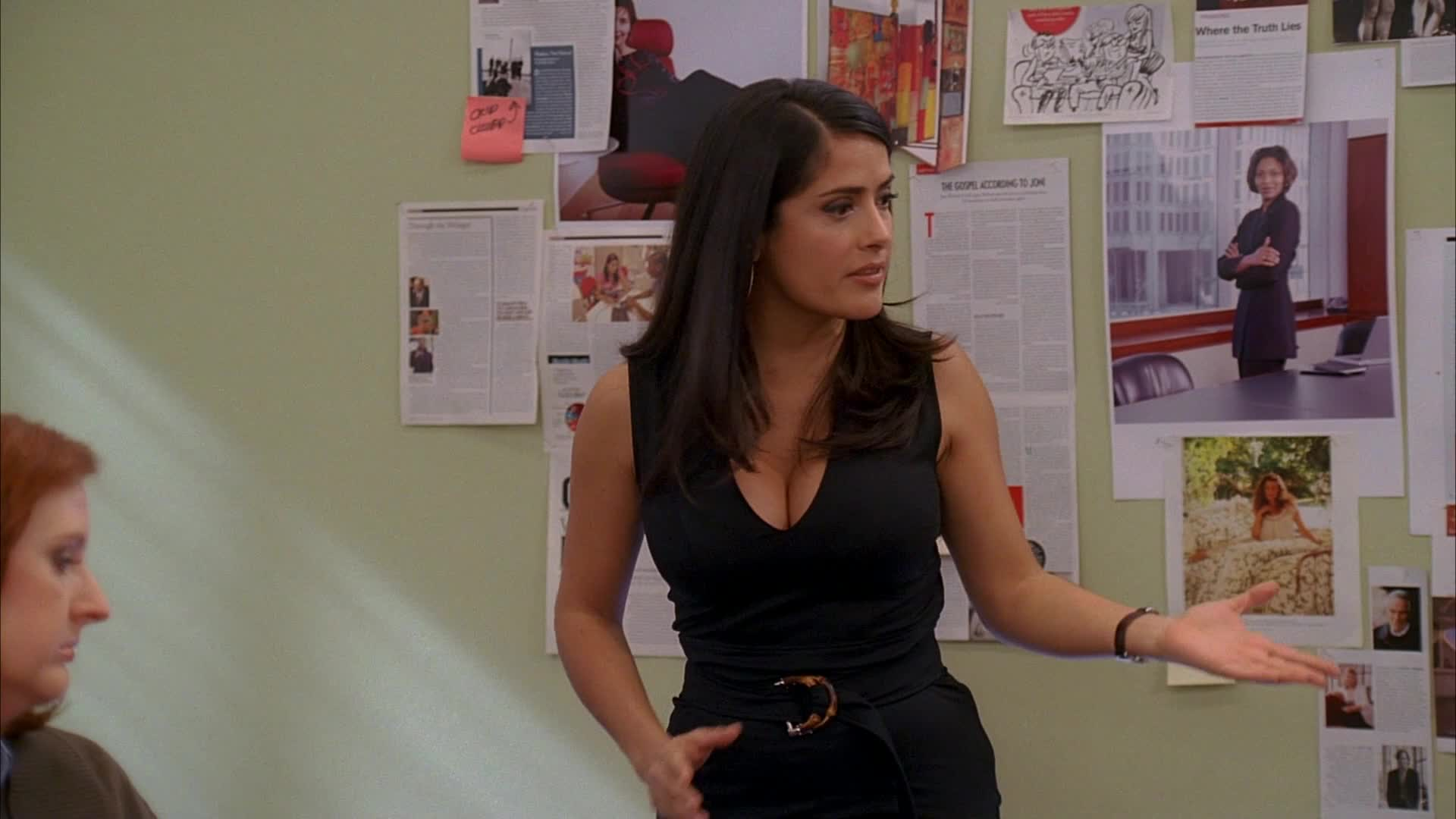 Salma Hayek conducting a meeting in sexy black dress scene from Ugly Betty