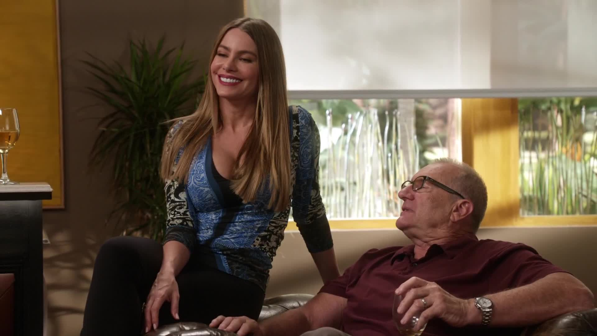 Sofia Vergara sexy cleavage sitting in couch scene from Modern Family