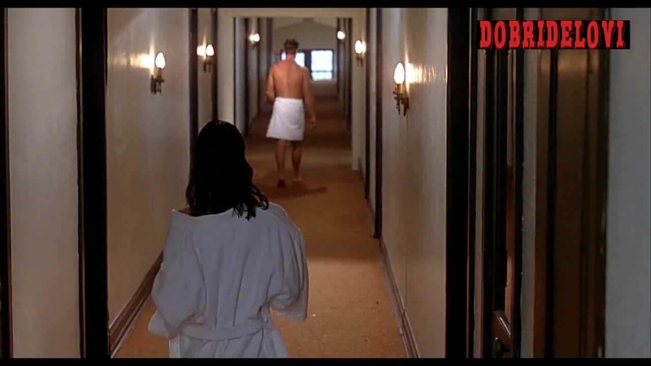 Charlotte Lewis open robe in the hallway