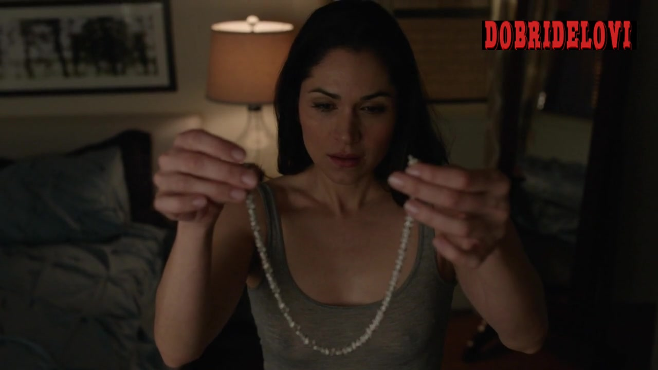 Lela Loren sexy putting on necklace in grey tank top
