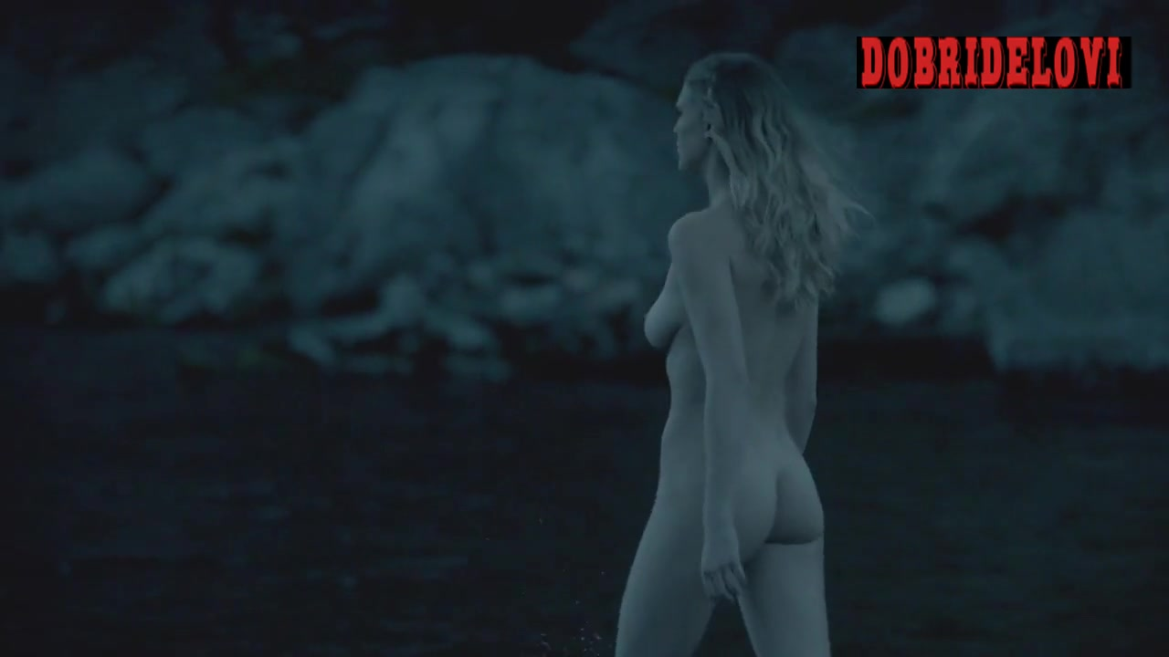 Gaia Weiss undresses and walks into the water nude scene from Vikings