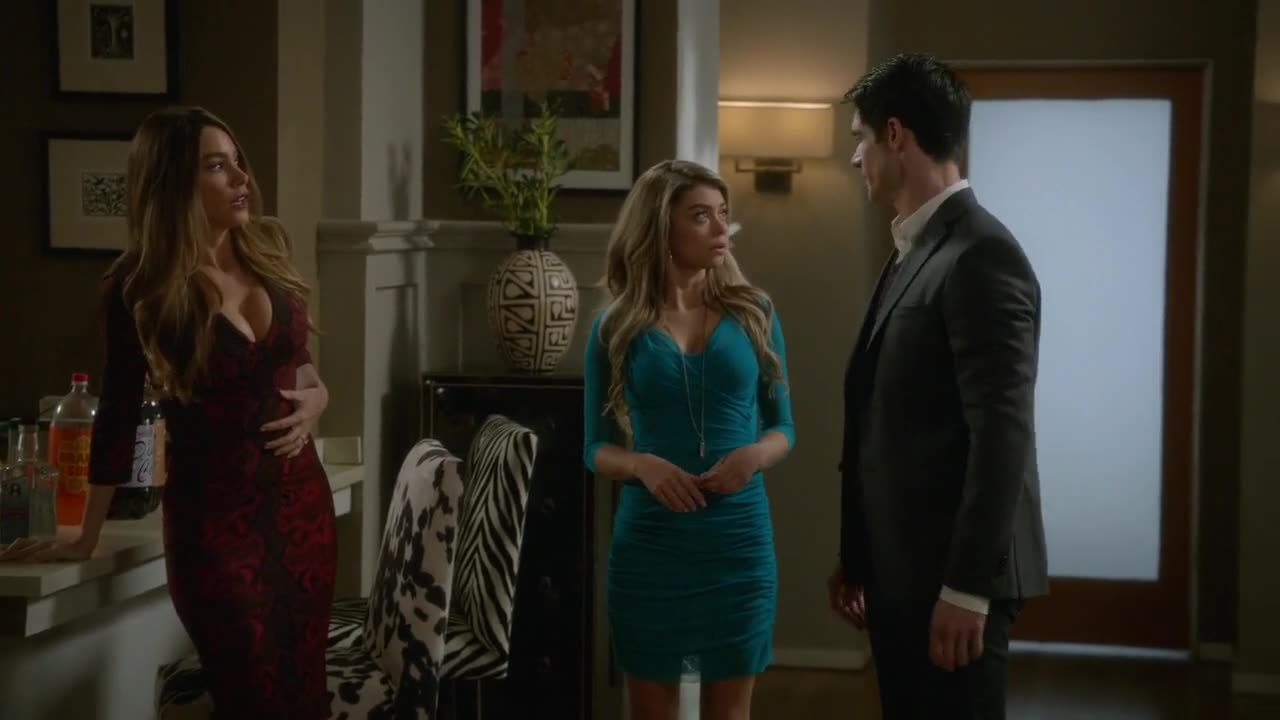 Sofia Vergara cleavage in red dress scene from Modern Family