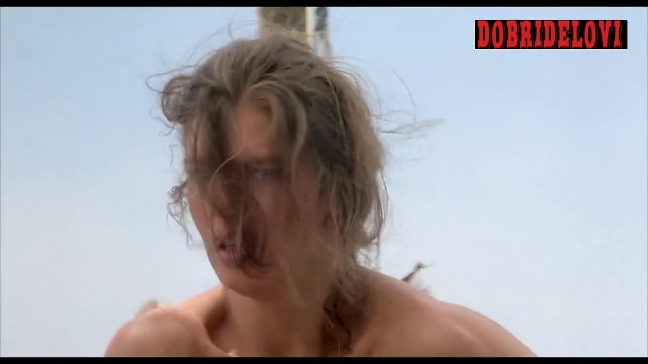 Jeanne Tripplehorn nude holding gun scene from Waterworld video image