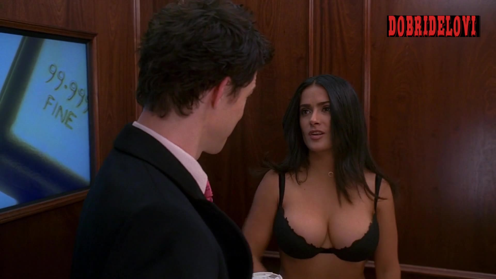 Salma Hayek unbuttons top in elevator scene from Ugly Betty