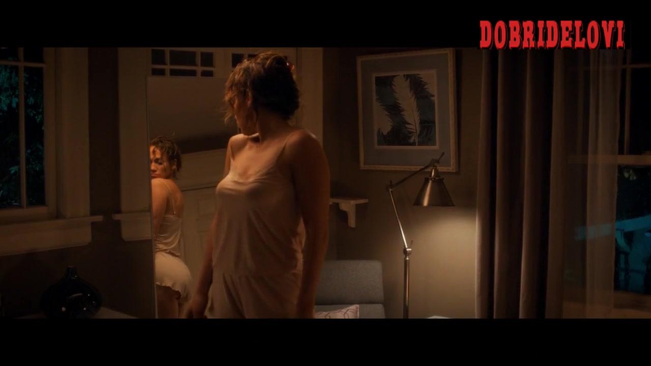 Jennifer Lopez sexy white dress looking at mirror