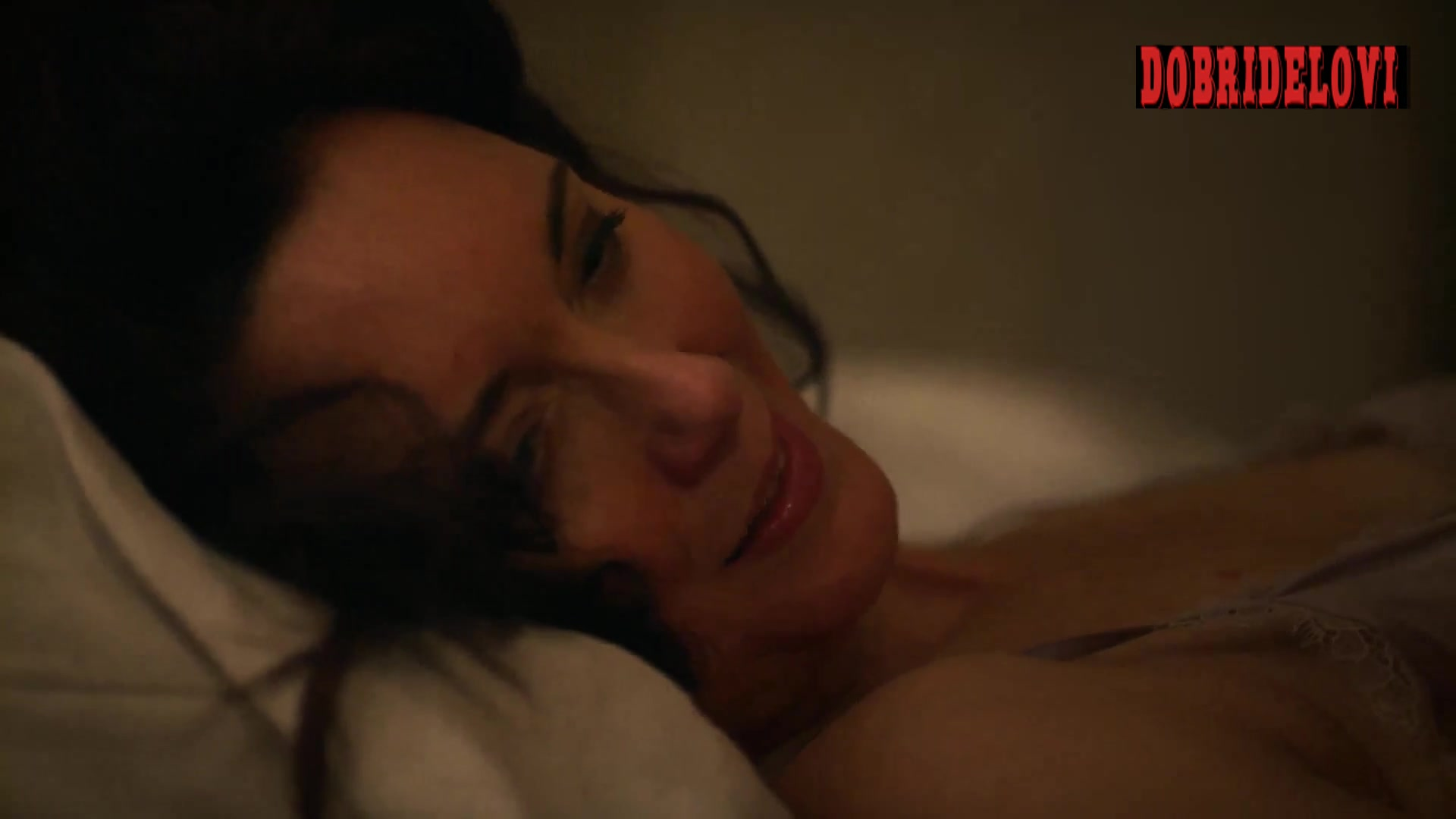 Julia Campbell laying in bed in dark room scene -- The Resident
