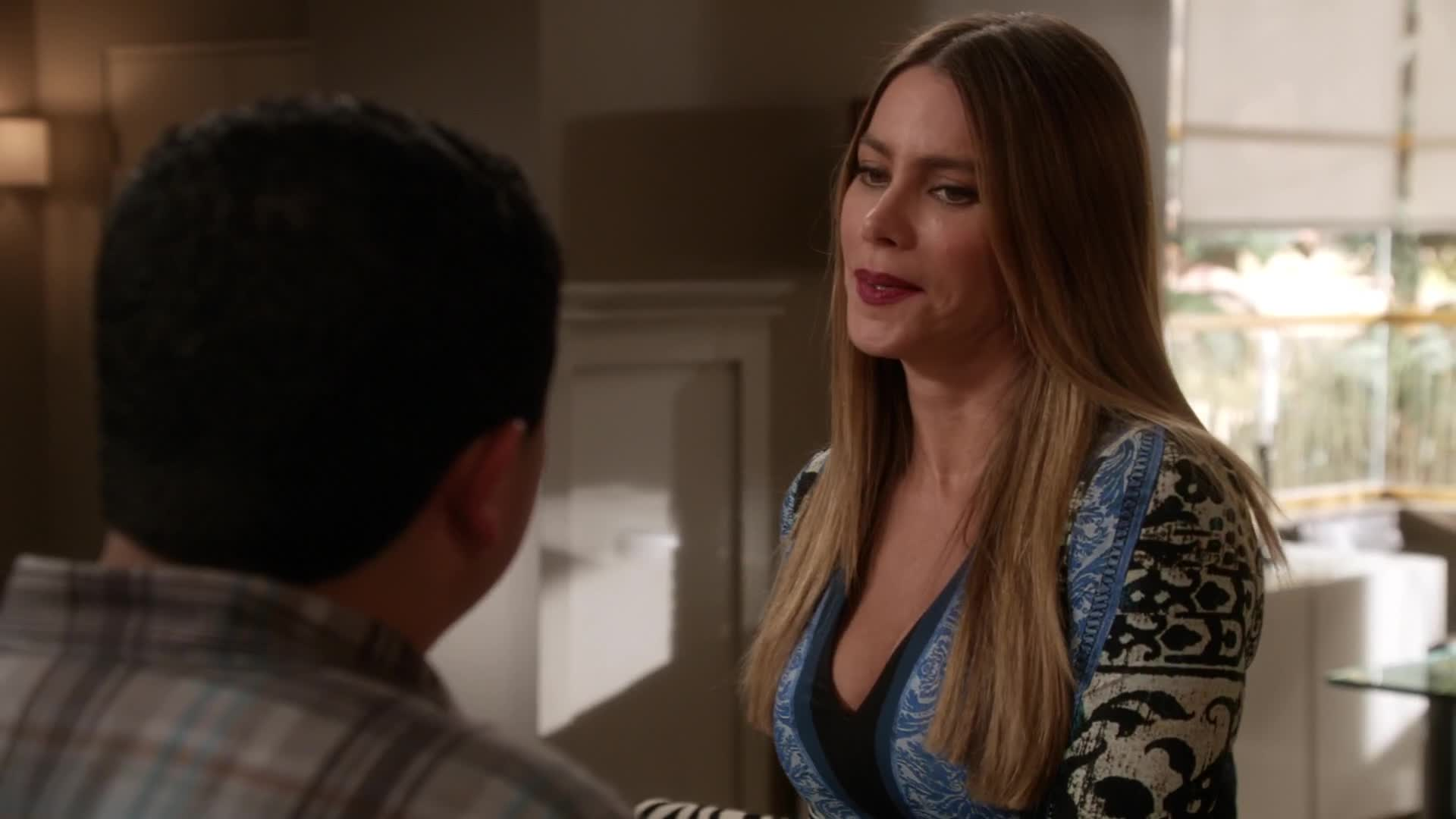 Sofia Vergara sexy cleavage in blue top scene from Modern Family