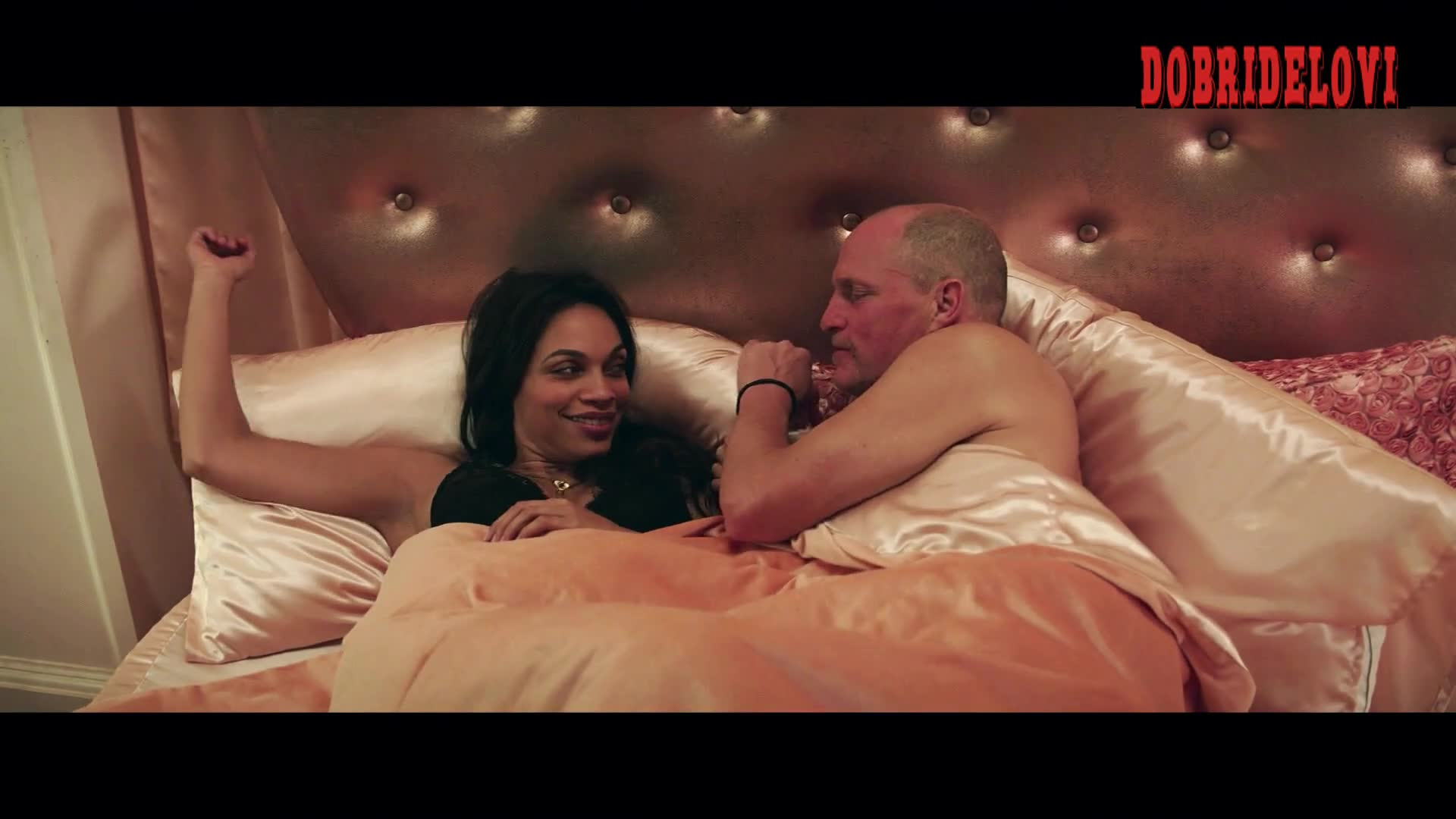 Rosario Dawson lays in bed with Woody Harrelson for Zombieland Double Tap