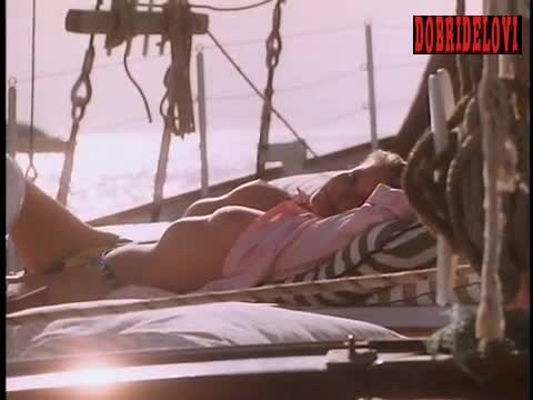 Bo Derek breasts exposed sunbathing in sailboat scene from Woman of Desire
