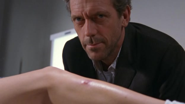 Dr. House inspects Carmen Electra