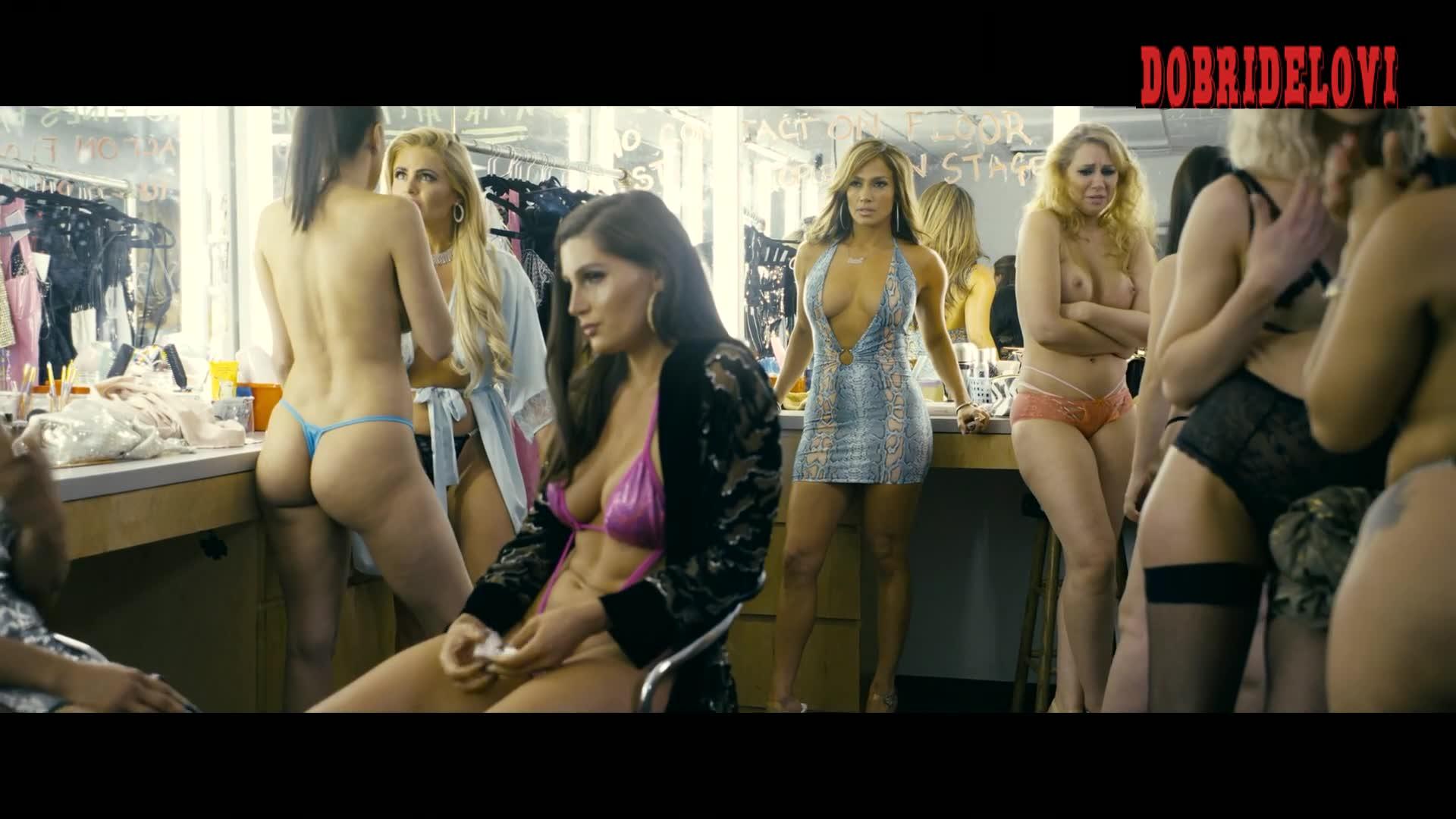 Jacqueline Frances stands naked next to Jennifer Lopez in Hustlers