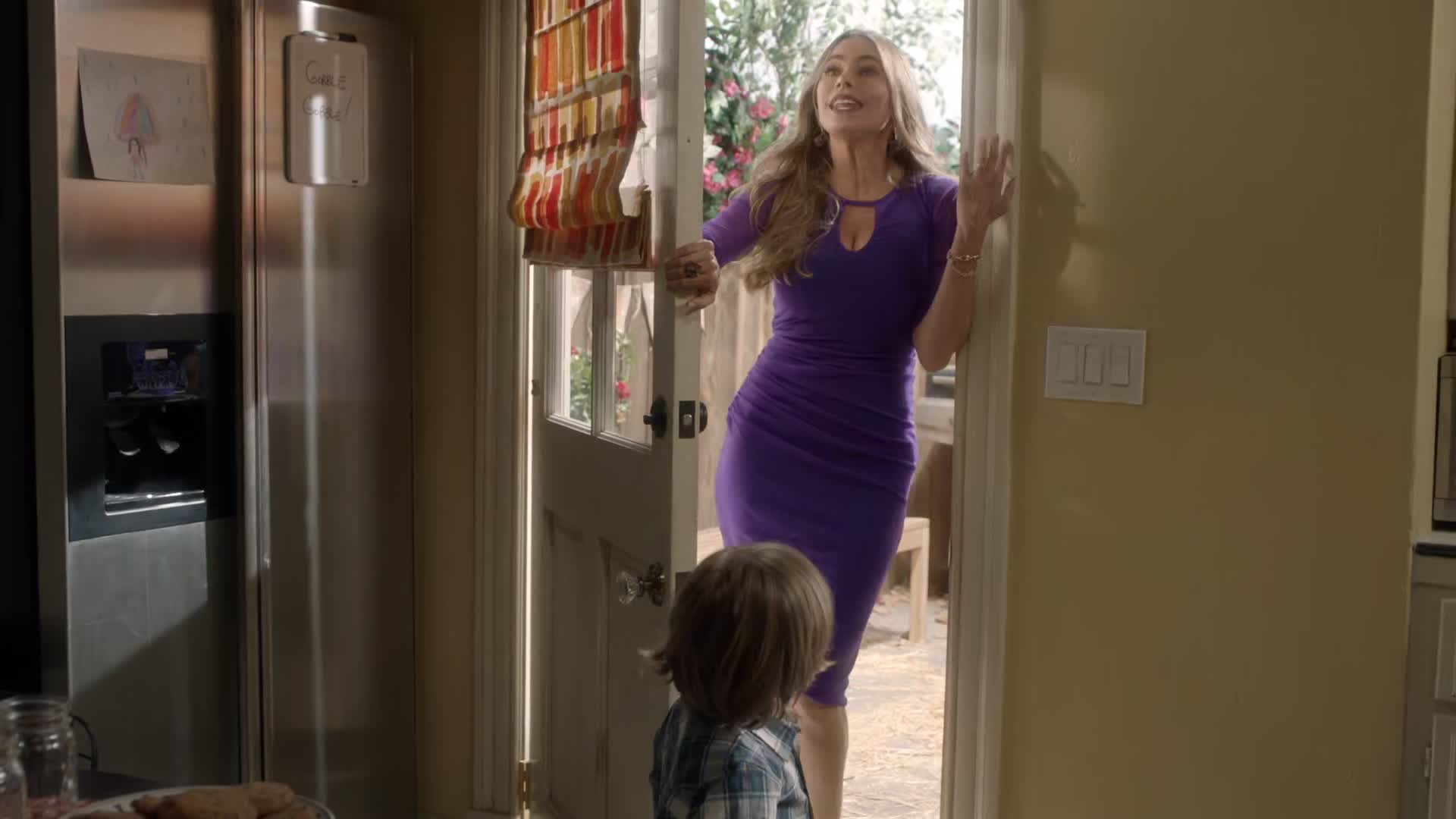 Sofia Vergara sexy blue dress scene from Modern Family