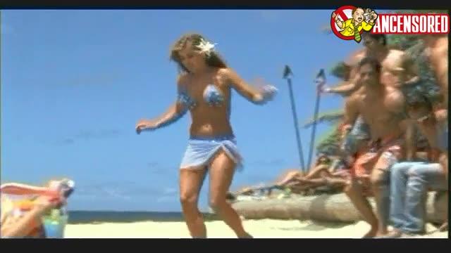 Pamela Anderson sunbathing in Baywatch Hawaiian Wedding