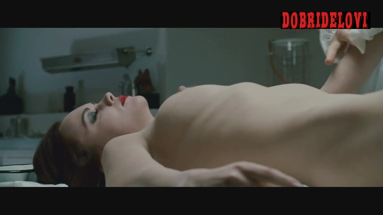 Christina Ricci laying naked with Liam Neeson preparing her