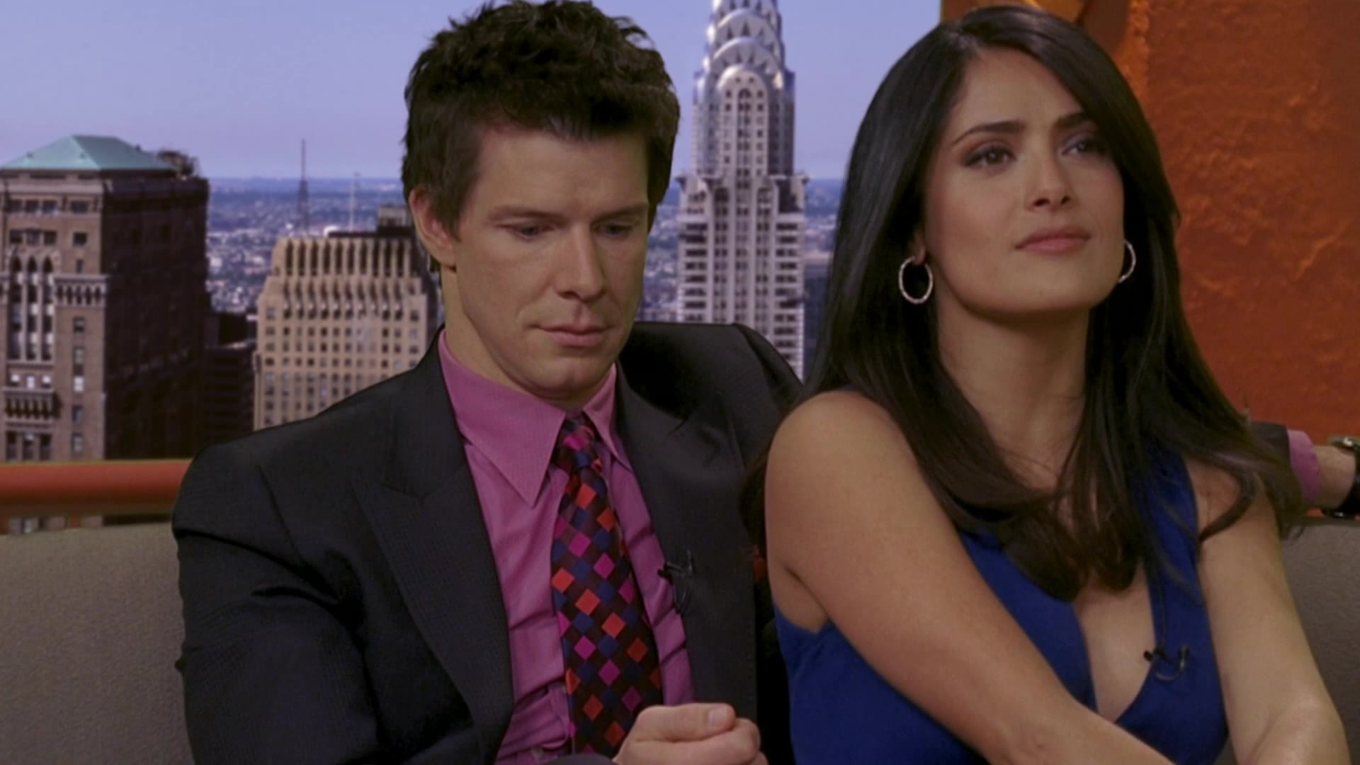 Salma Hayek sexy cleavage in blue dress being interviewed with Eric Mabius -- Ugly Betty