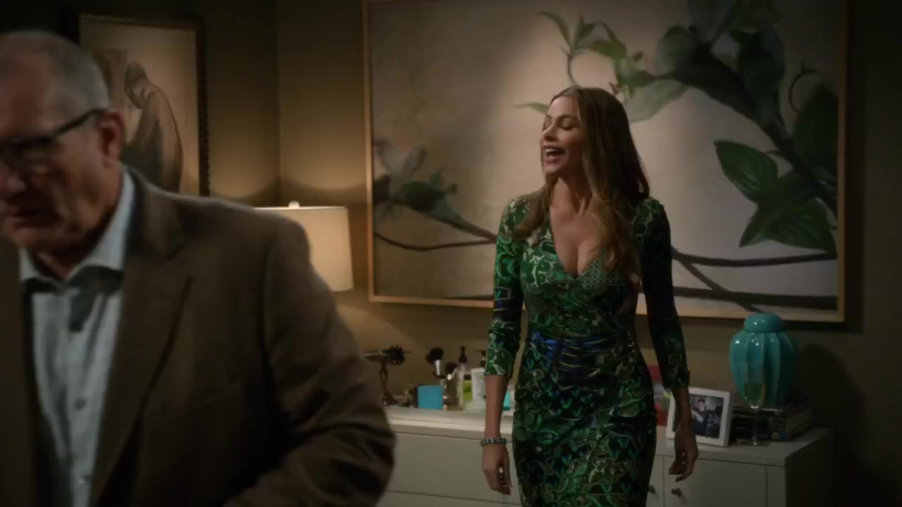 Sofia Vergara sexy cleavage in green dress scene from Modern Family