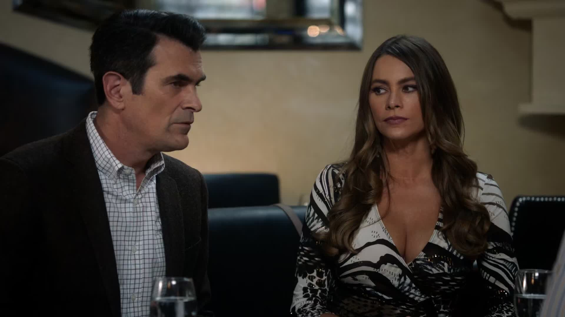 Sofia Vergara huge cleavage at table with Ty Burrell and Eric Stonestreet