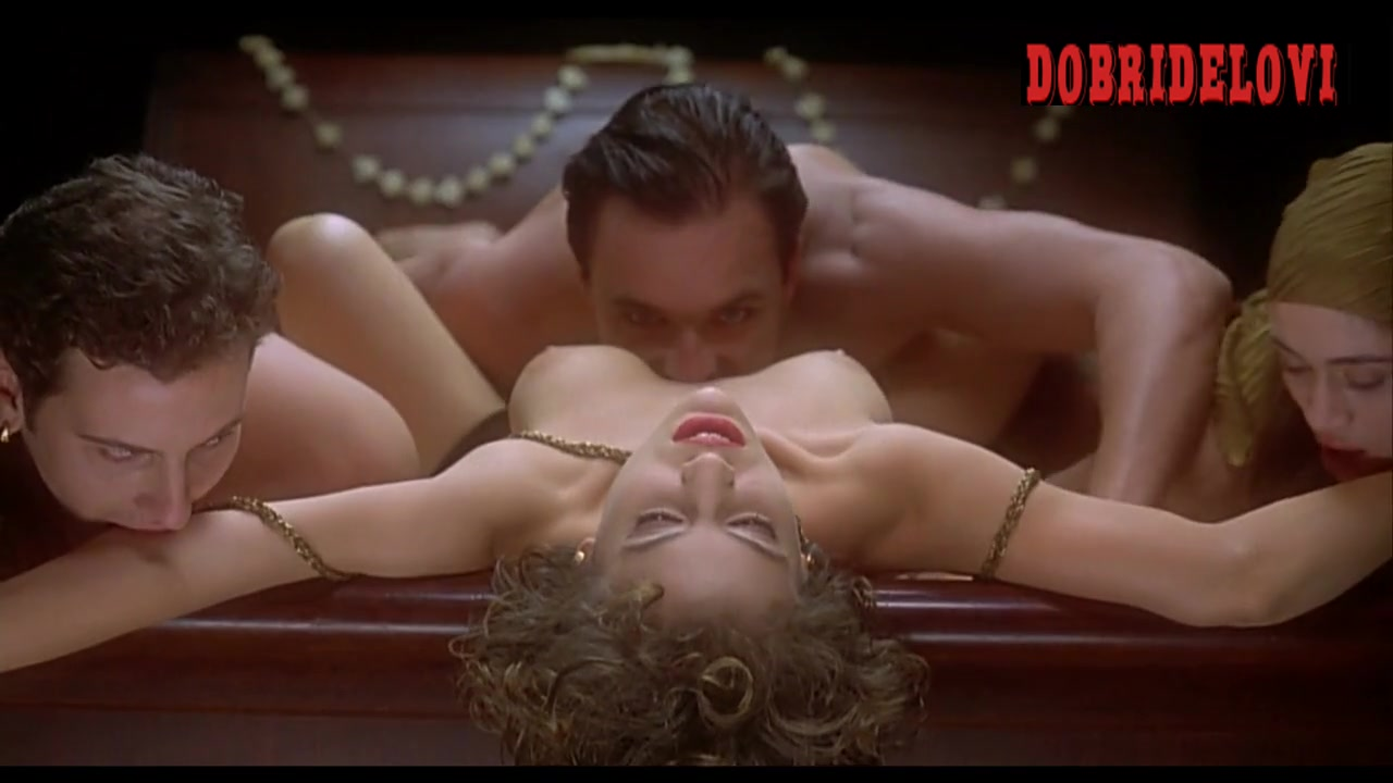 Alyssa Milano lays nude in bed with three vampires jumping on her