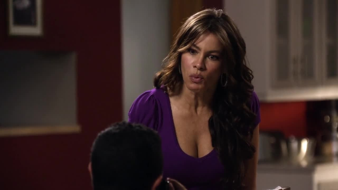 Sofia Vergara sexy cleavage in purple top for Modern Family