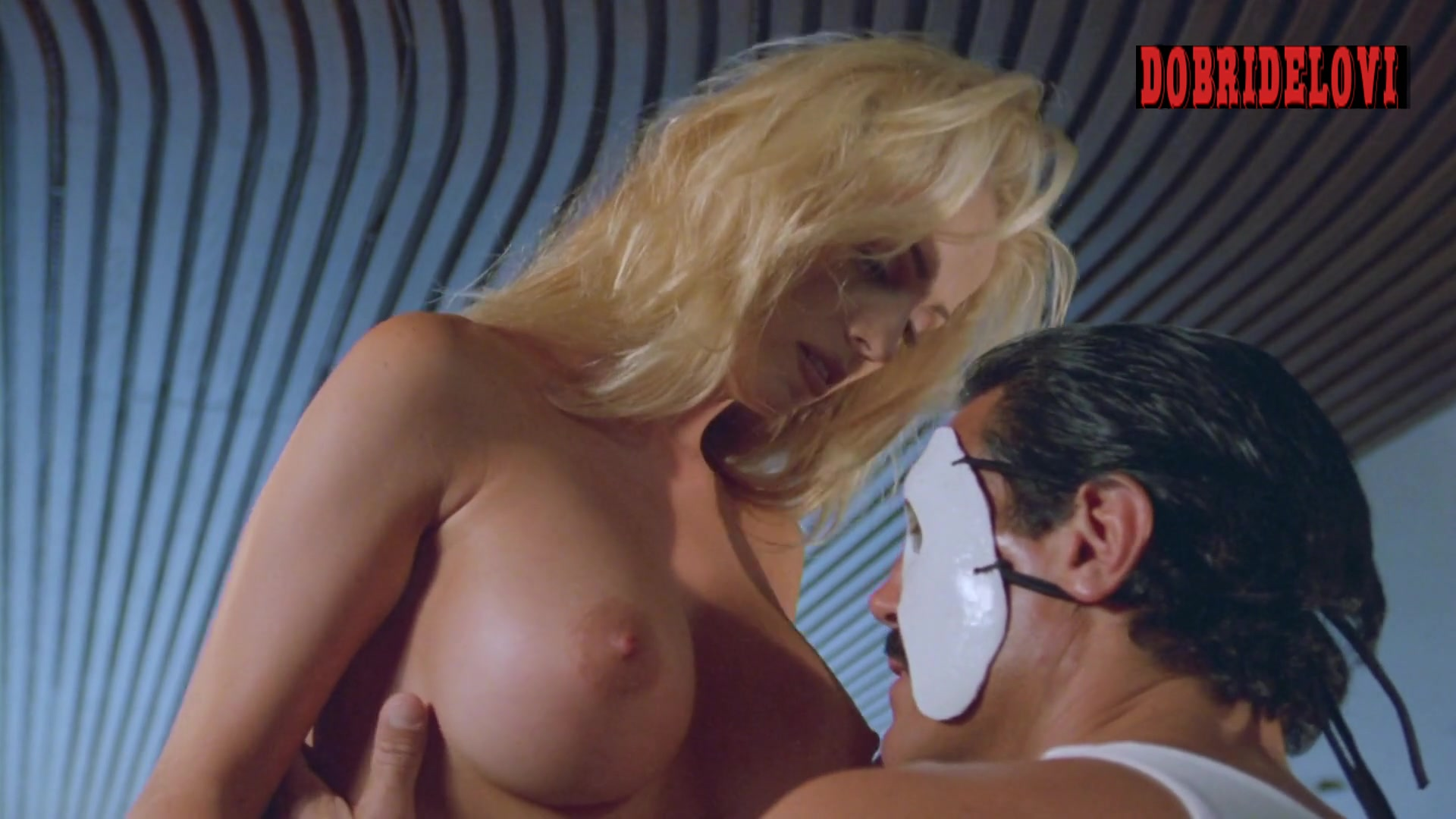 Carrie Westcott taking off bra scene from L.E.T.H.A.L. Ladies: Return to Savage Beach