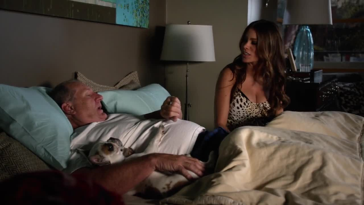 Sofia Vergara laying in bed in nightie scene from Modern Family