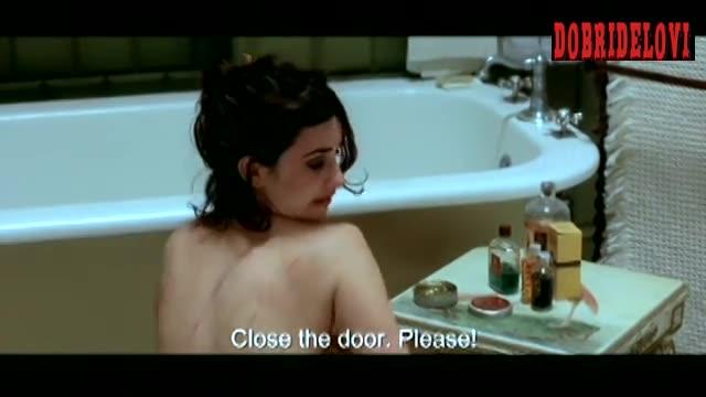 Penélope Cruz sitting on floor in bathroom scene from Head in the Clouds