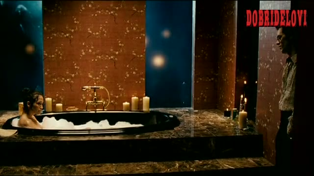 Jennifer Lopez joined by Marc Anthony in the bathtub scene from El cantante