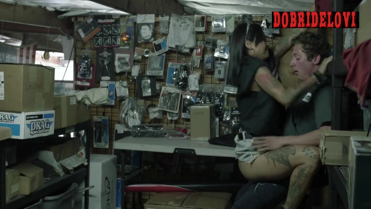 Levy Tran roughly rides Jeremy Allen White in the mechanic shop