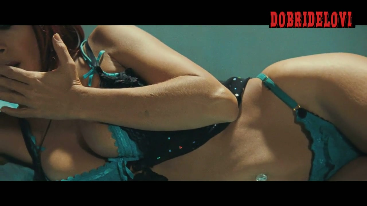 Salma Hayek lays in green bikini in this close up scene from Americano