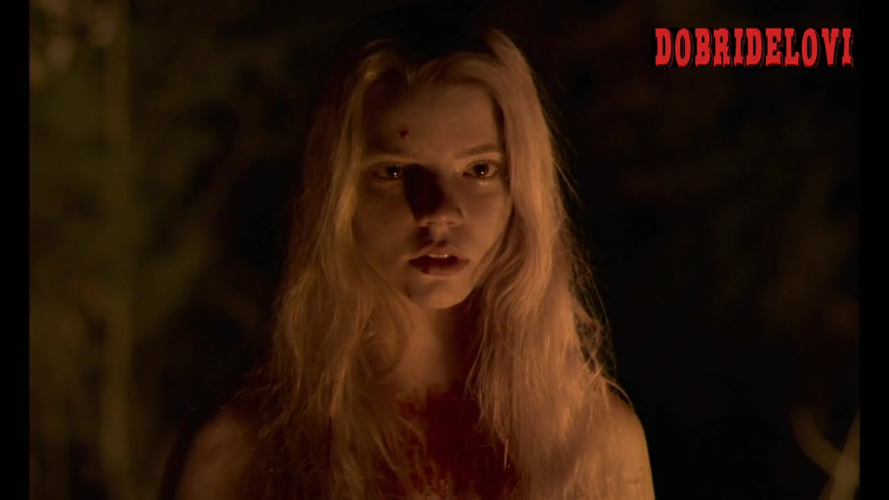Anya Taylor-Joy walking through the woods scene from The Witch