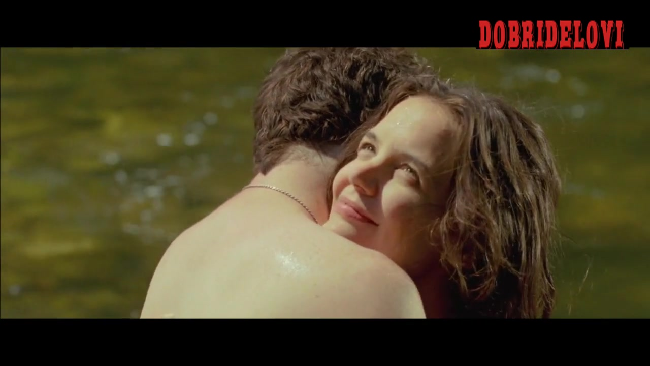 Katie Holmes bathing in river scene from Touched With Fire
