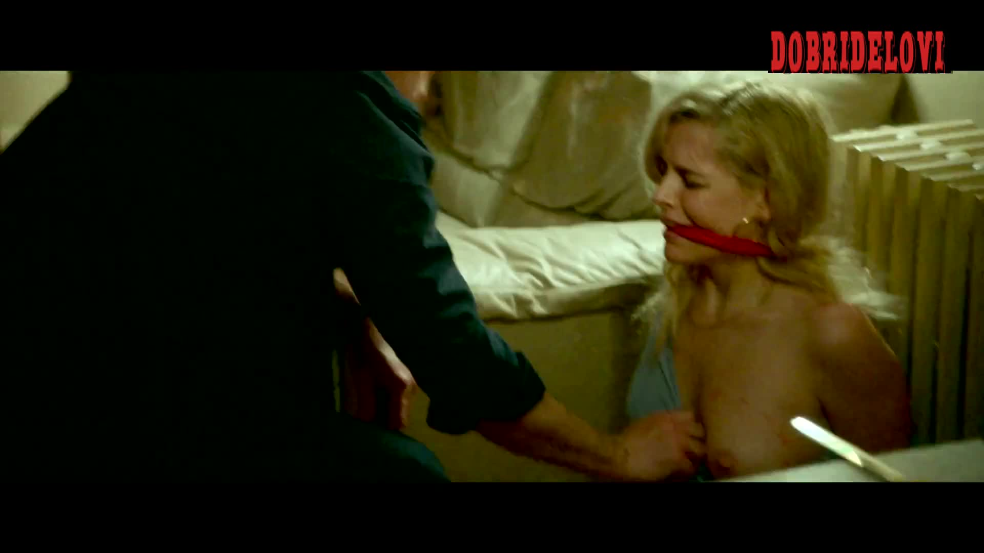 Riley Keough gagged and shirt pulled down scene from The House That Jack Built