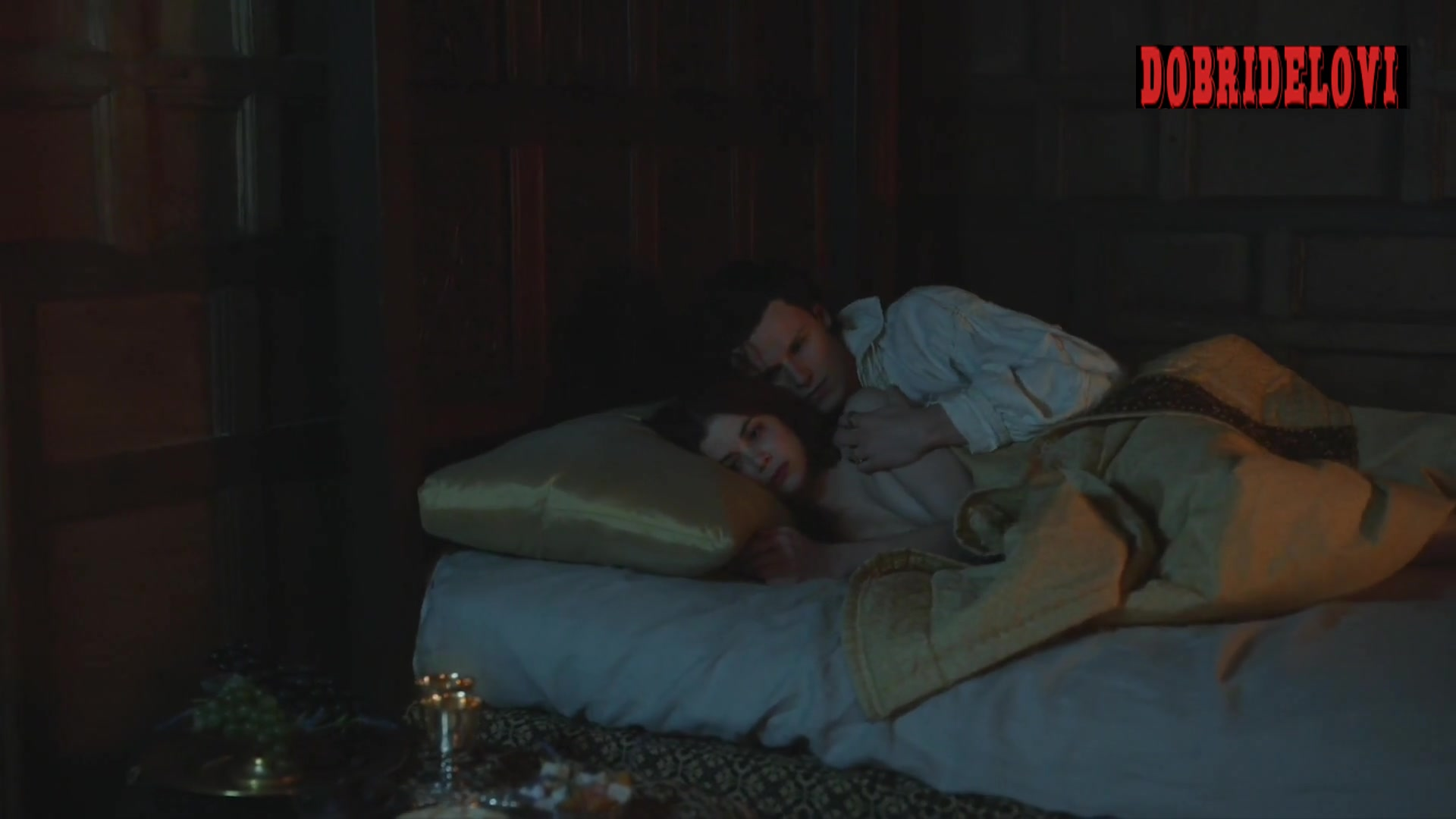 Sai Bennett, and Charlotte Hope spooning sex scene from The Spanish Princess