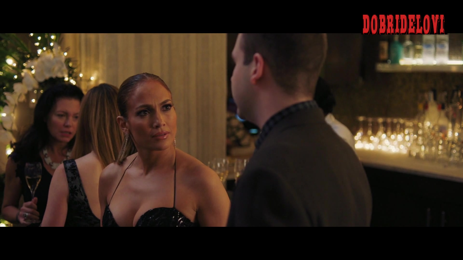 Jennifer Lopez wearing sexy black dress in party scene from Second Act