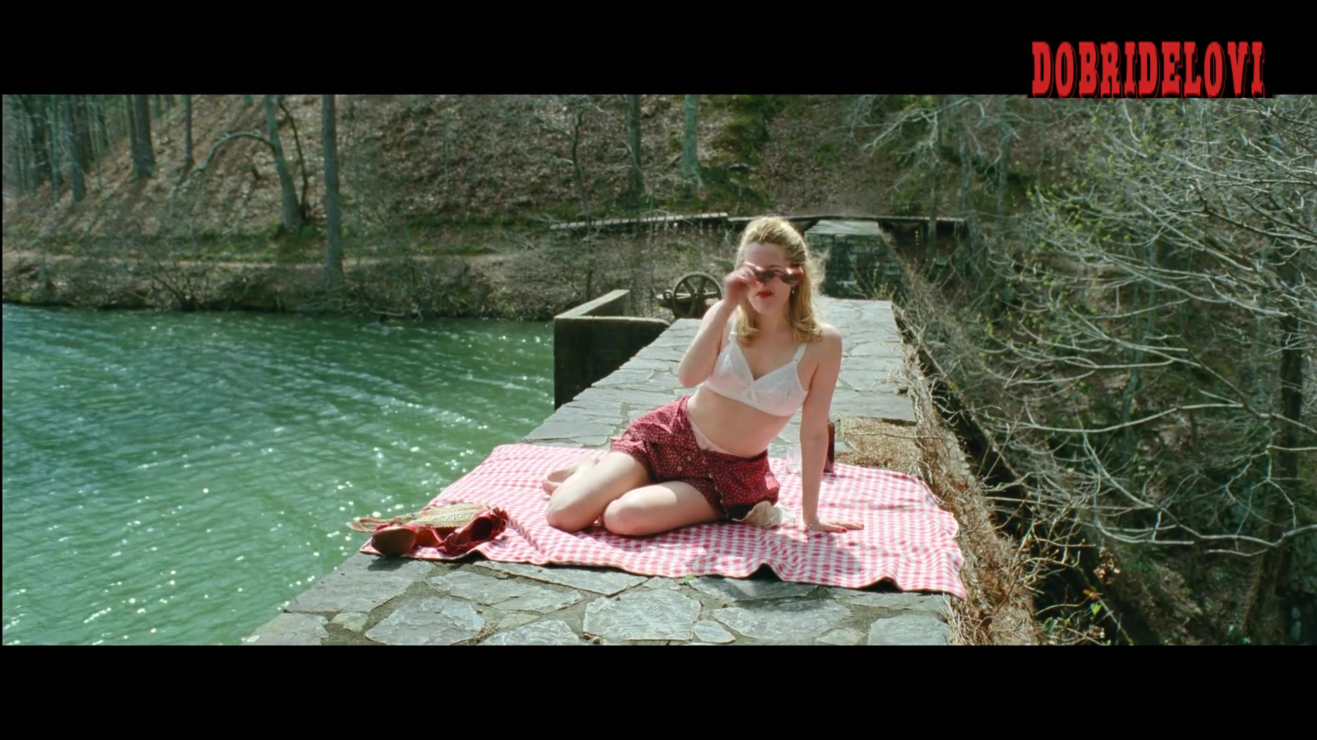 Riley Keough picnic in the woods scene from The Devil All the Time