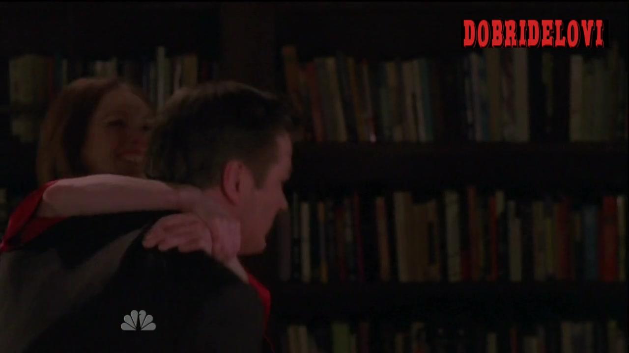 Julianne Moore in red lingerie carryied by Alec Baldwin scene from 30 Rock