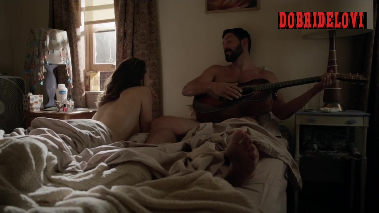 Emmy Rossum lays nude in bed with dude playing guitar scene from Shameless