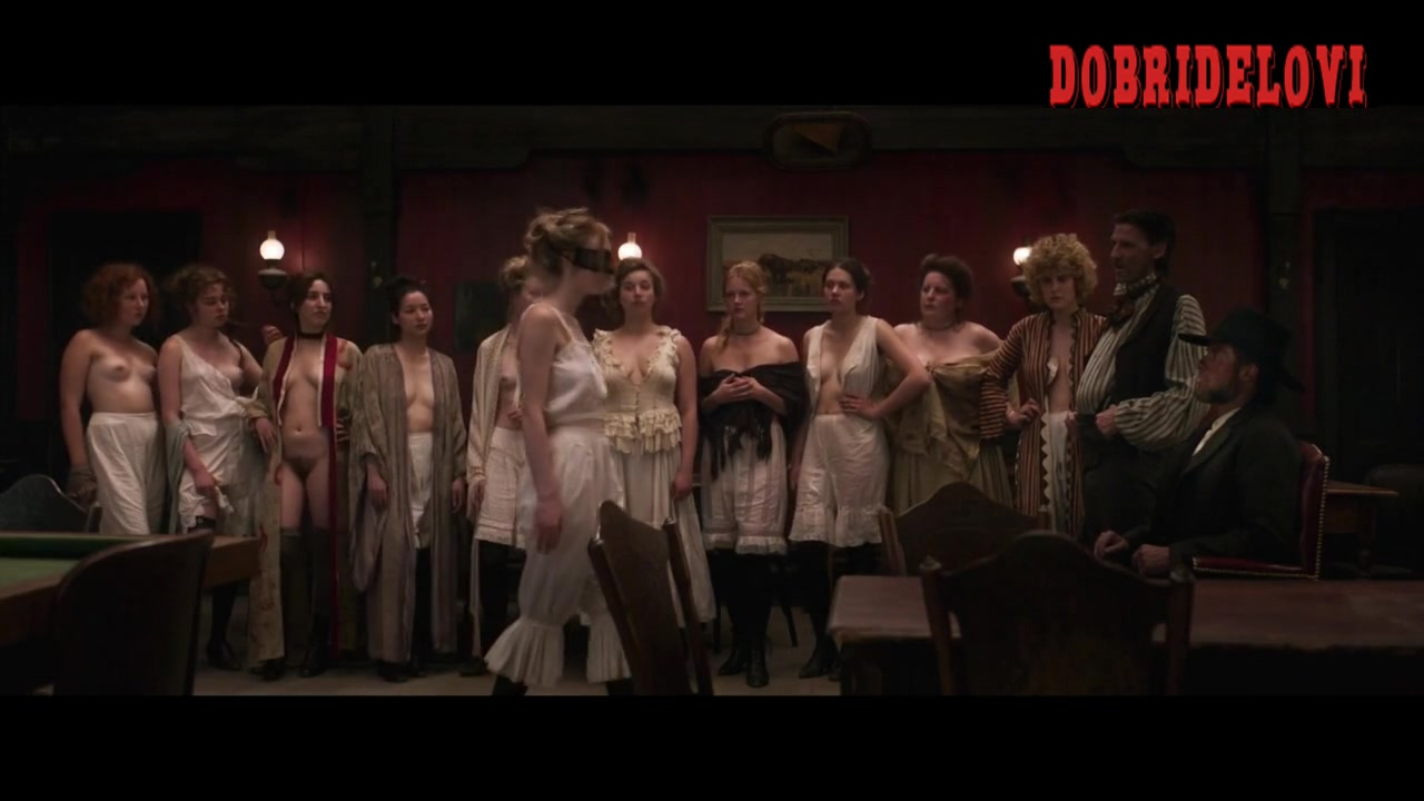 Carla Juri and Dakota Fanning girls line up in brothel scene from Brimstone