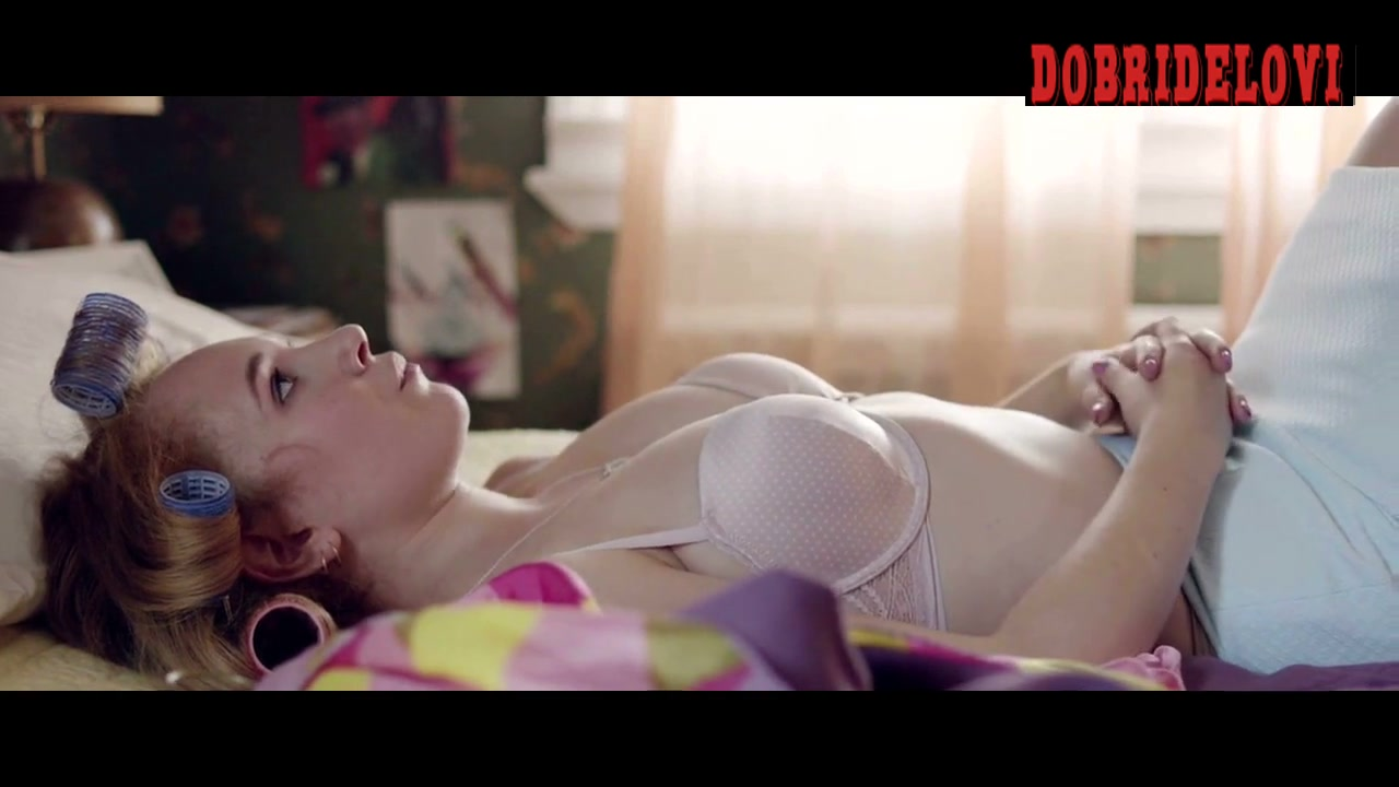 Juno Temple laying in bed with curlers scene from The Brass Teapot