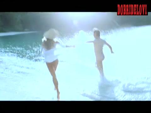 Deborah Kara Unger running in the beach scene from Stander