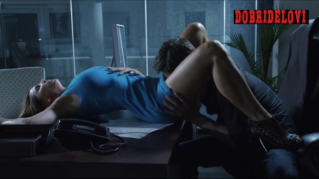 Watch Charisma Carpenter oral sex in desk scene from Bound video