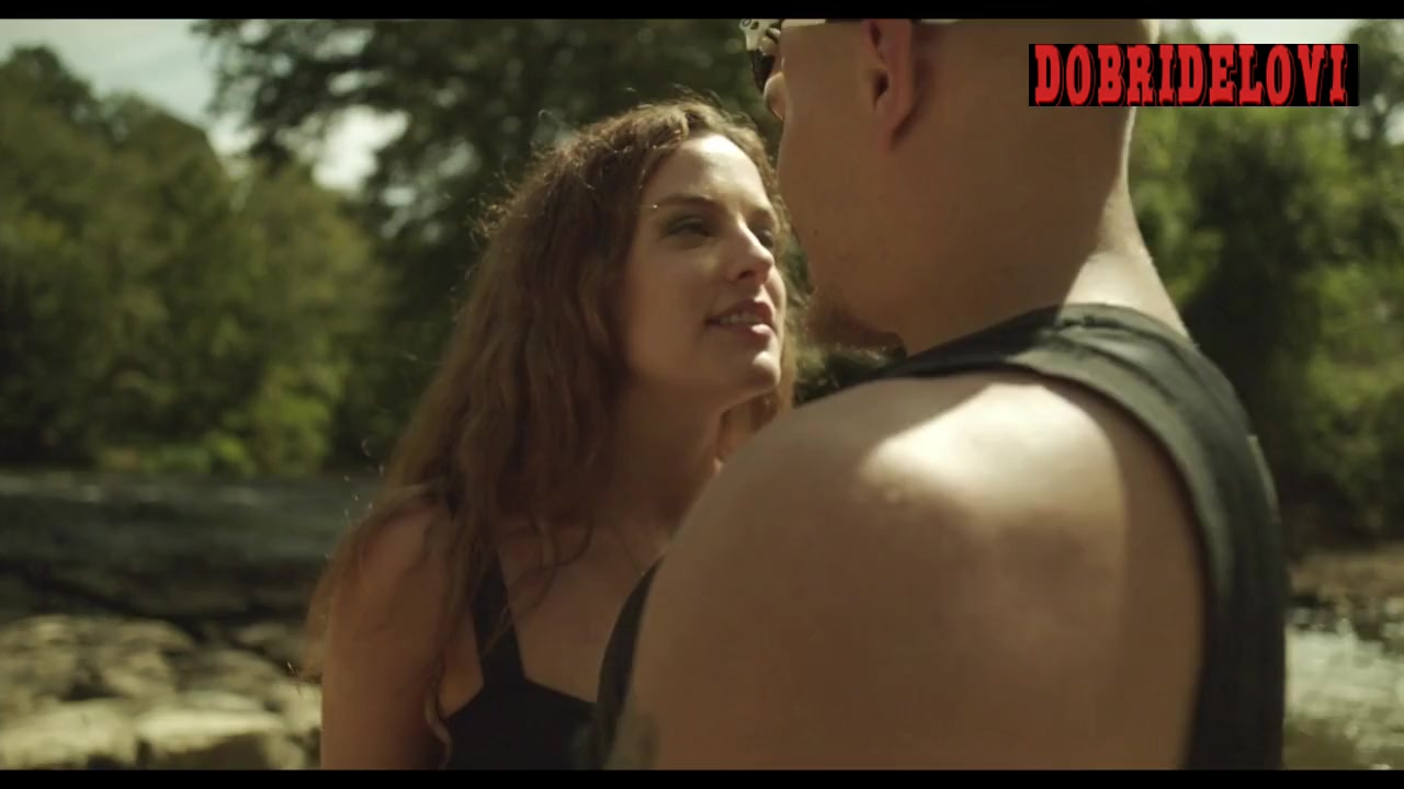 Riley Keough dancing in the woods with cheeky shorts scene from Dixieland