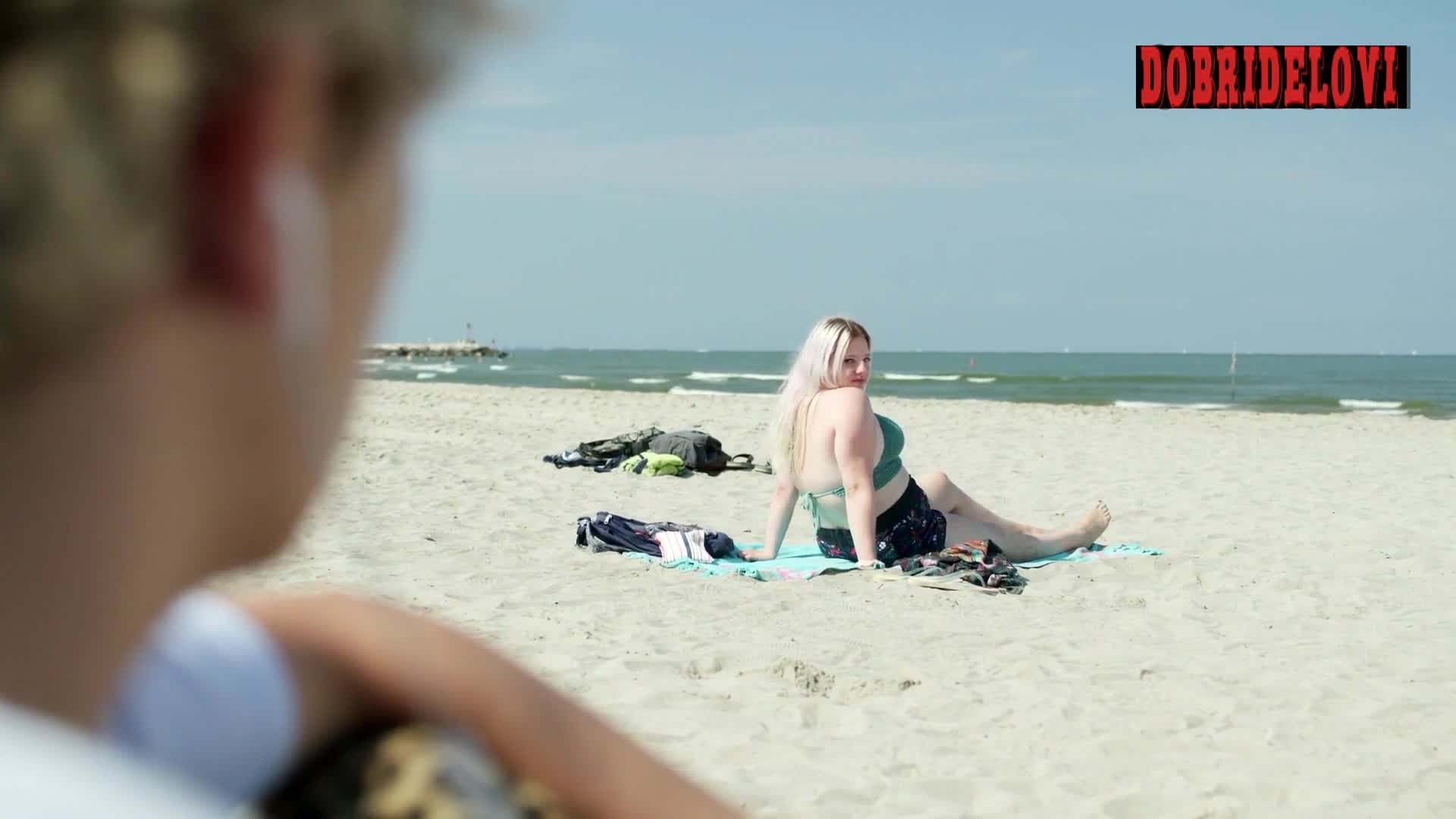 Francesca Scorsese sitting in the beach scene from We Are Who We Are