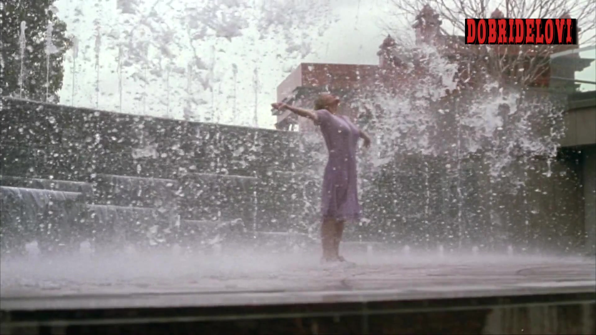 Elisabeth Shue playing in the fountain scene from Molly