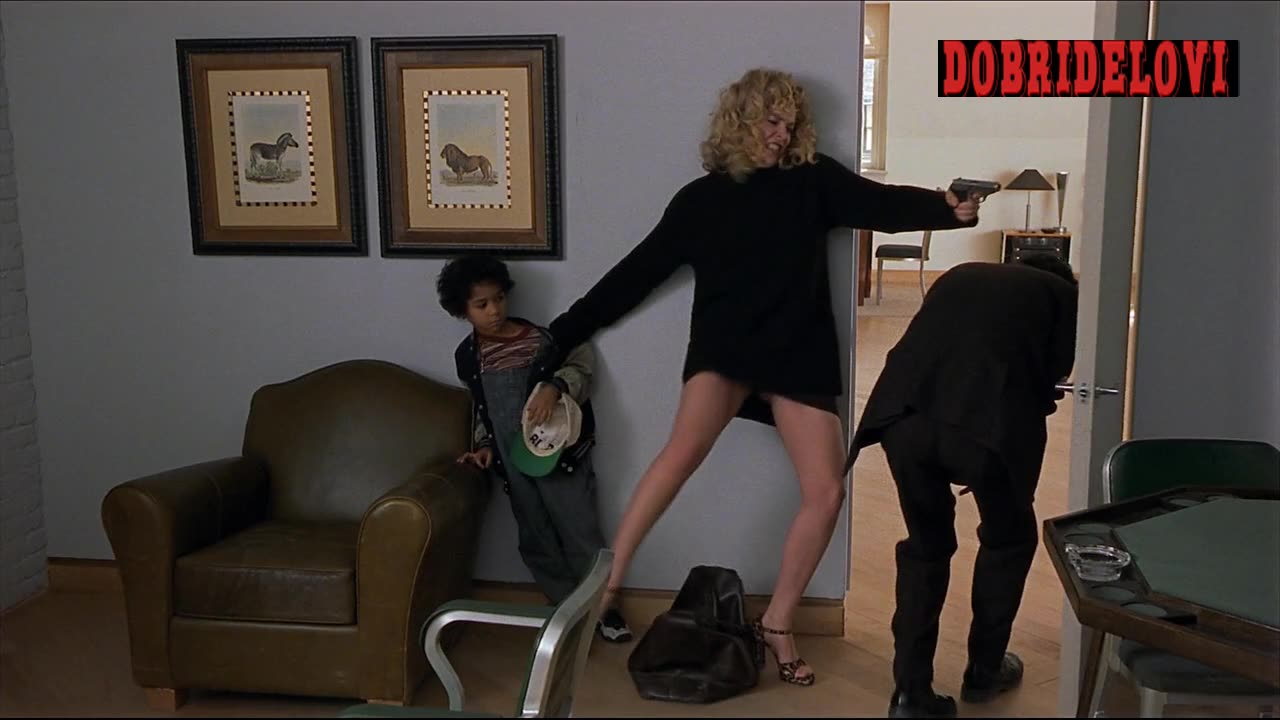 Sharon Stone kicking guy in the butt scene from Gloria